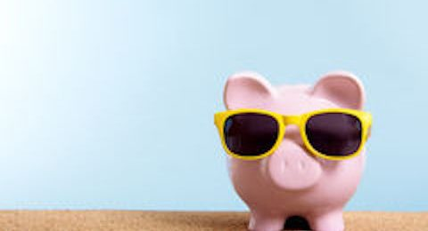 retirement-fund-travel-money-concept-piggy-bank-summer-beach-vacation-copy-space-pink-yellow-sunglasses-55400153
